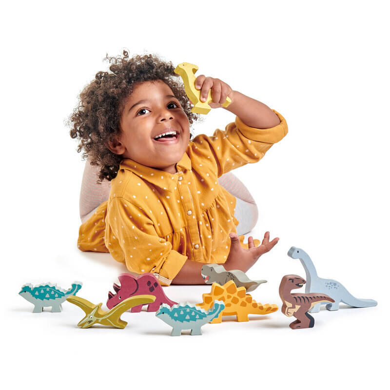 child playing with tenderleaf dinosaurs