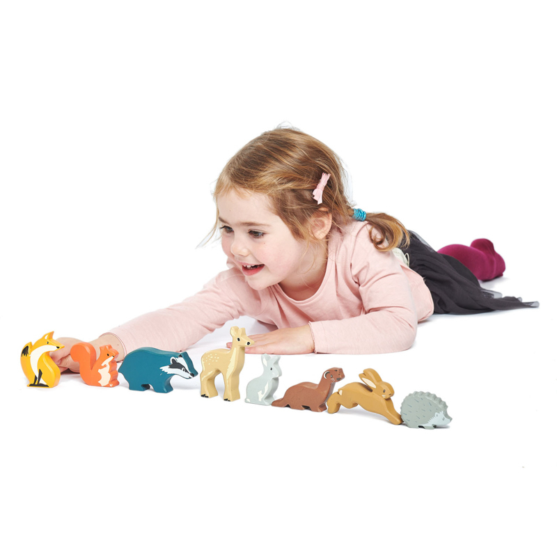 girl plays with woodland animals tender leaf toys