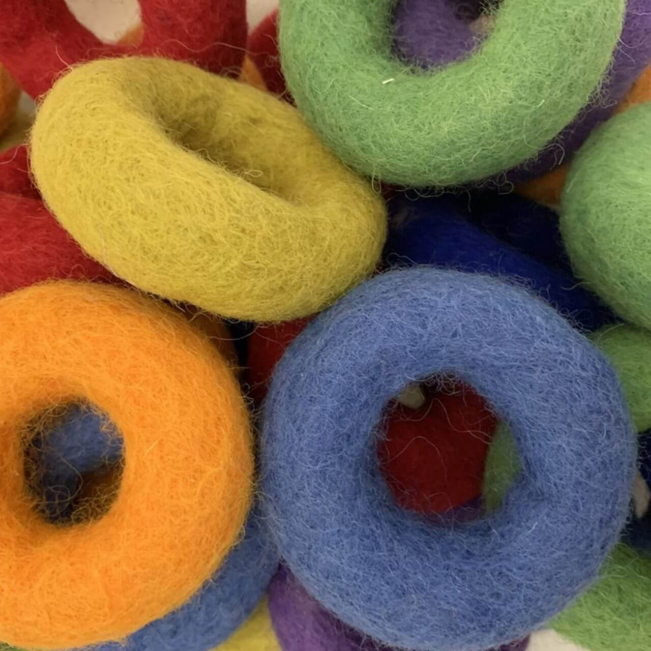 papoose rainbow wool felt donut rings